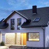 Фото дома с кровельным покрытием модульной металлочерепицей Germania Simetric