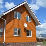 Отделка частного дома металлическим сайдингом Grand Line Экобрус