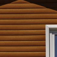 Обшивка дома сайдингом блок-хаус акрил Гранд Лайн